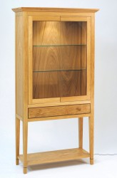 Display cabinet with interior soft lighting, a great show piece.